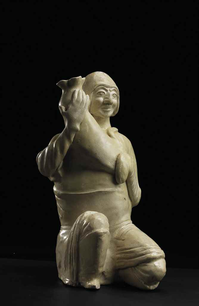 A WHITE-GLAZED HUMAN-SHAPED VE