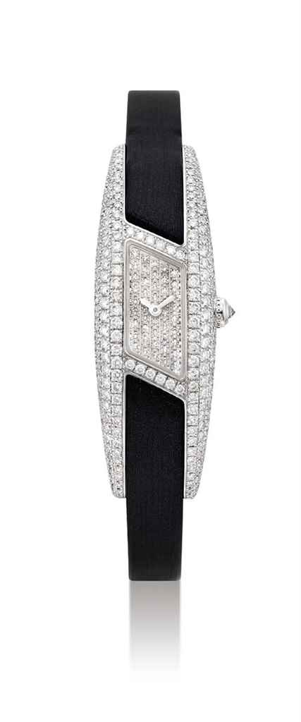 CARTIER. A LADY'S 18K WHITE GO