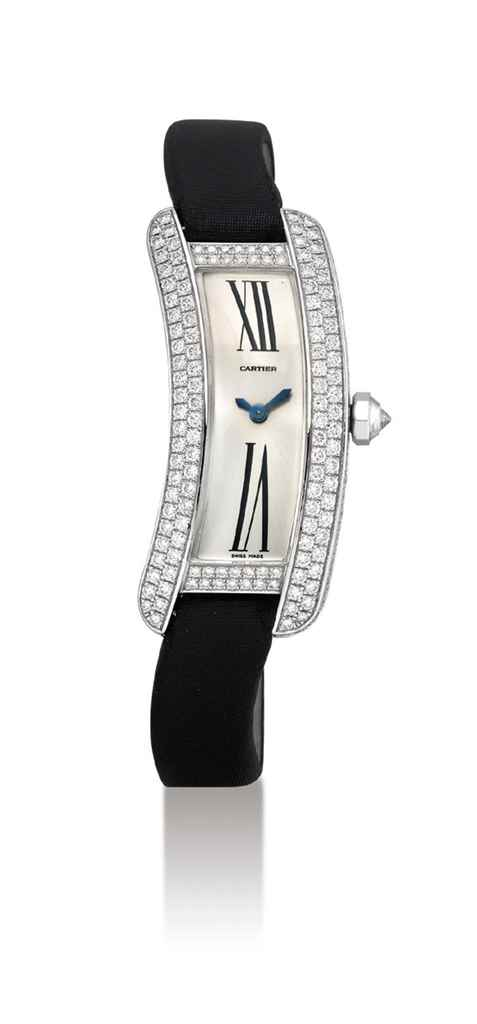 CARTIER. A LADY'S FINE 18K WHI