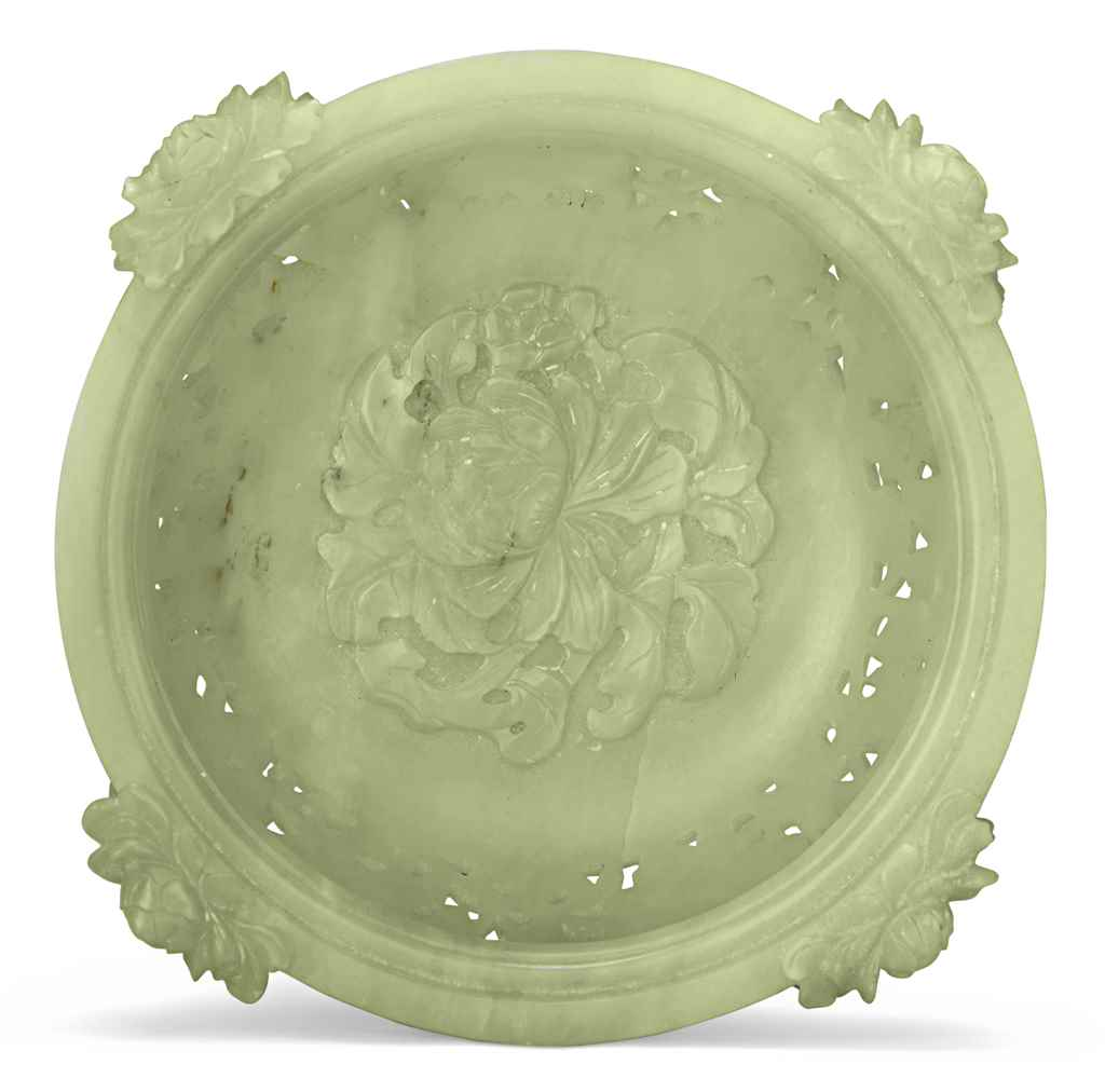 A CHINESE CELADON JADE PIERCED