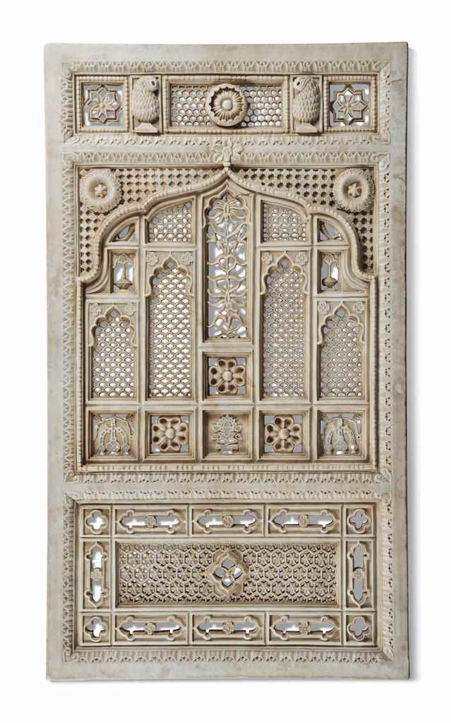AN INDIAN CARVED-MARBLE DOOR P