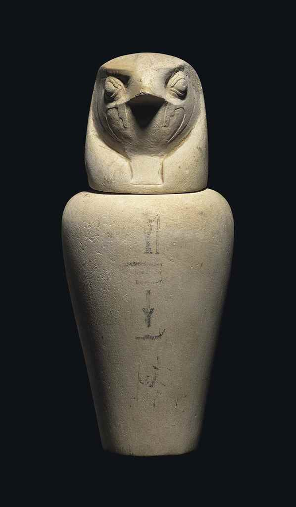 AN EGYPTIAN LIMESTONE CANOPIC