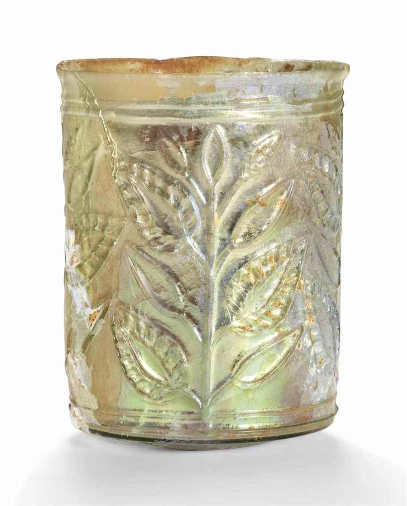 A ROMAN YELLOW-GREEN GLASS LEA