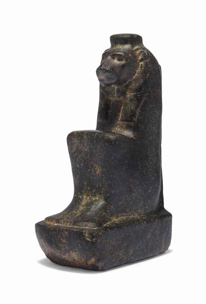 AN EGYPTIAN BASALT LION-HEADED