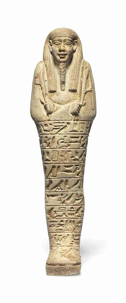 AN EGYPTIAN GREEN FAIENCE SHAB