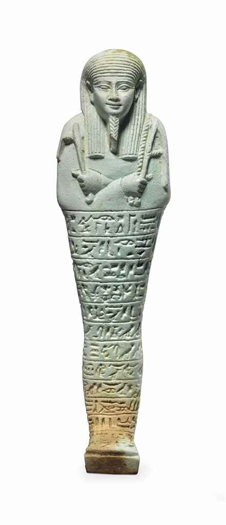 AN EGYPTIAN PALE GREEN FAIENCE