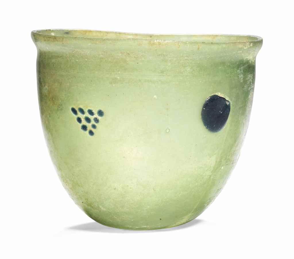 A LATE ROMAN YELLOW-GREEN GLAS