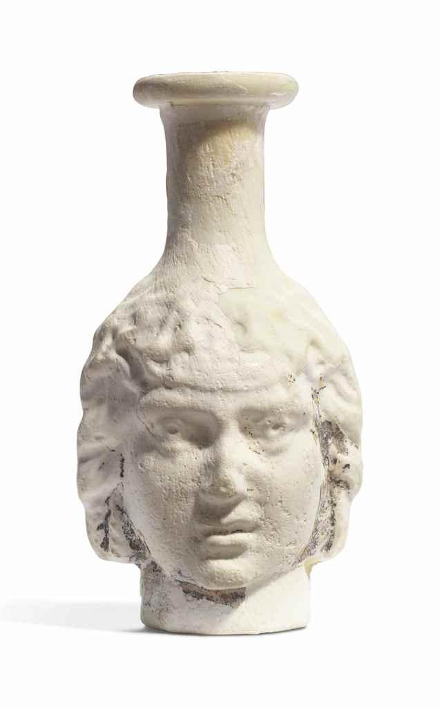 A ROMAN OPAQUE WHITE GLASS HEA