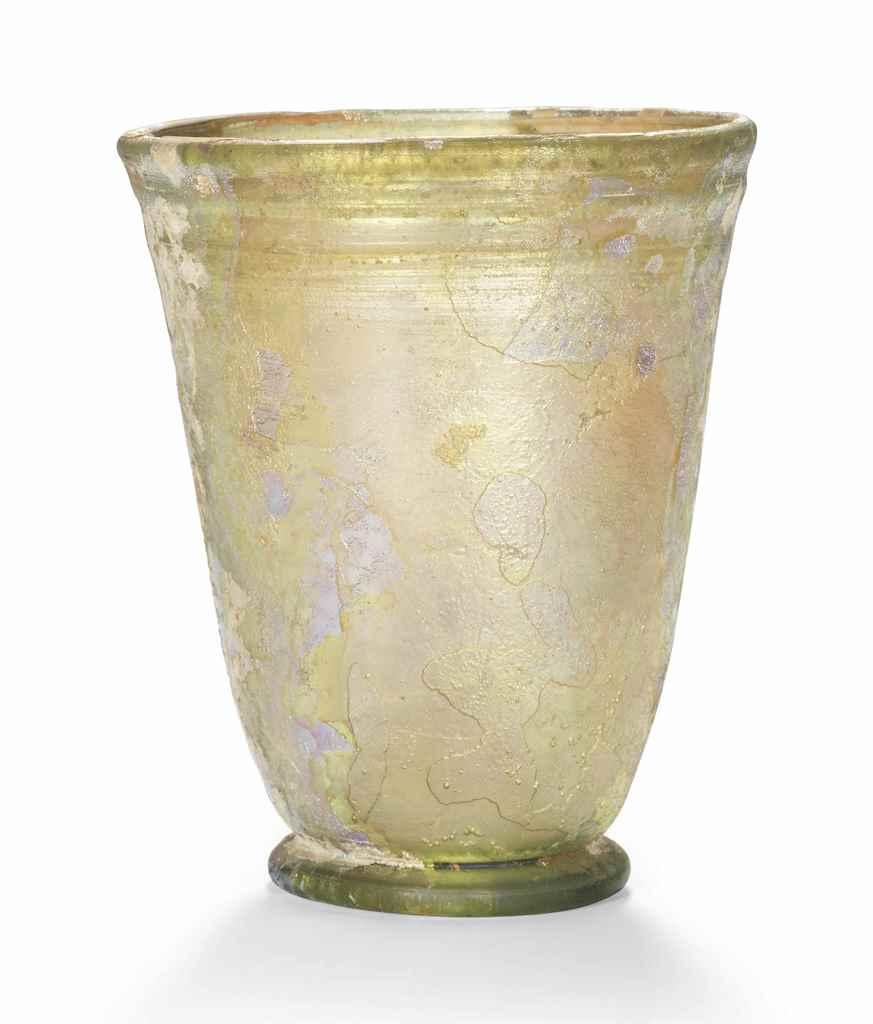 A ROMAN PALE GREEN GLASS BEAKE