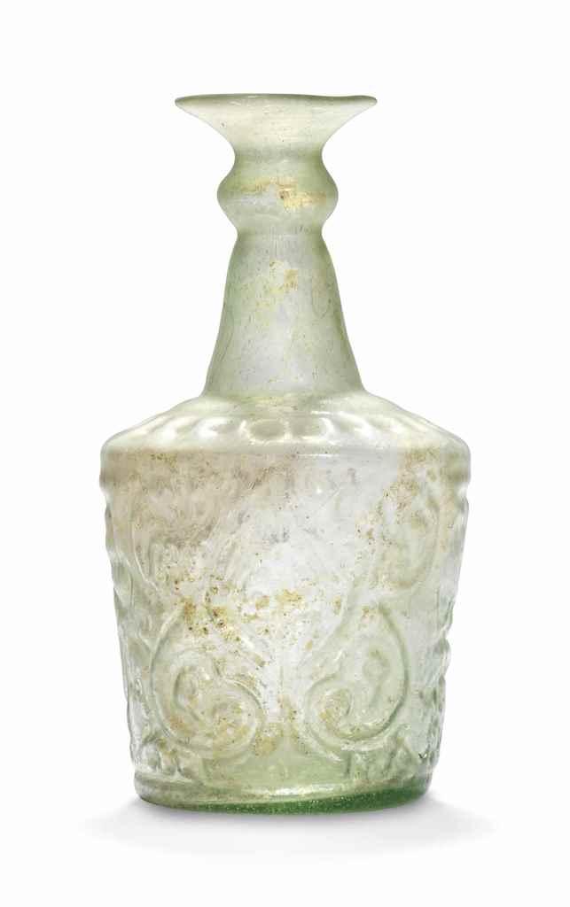 AN ISLAMIC PALE GREEN GLASS BO