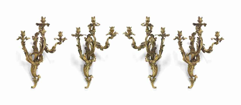 A SET OF FOUR ORMOLU THREE-LIG