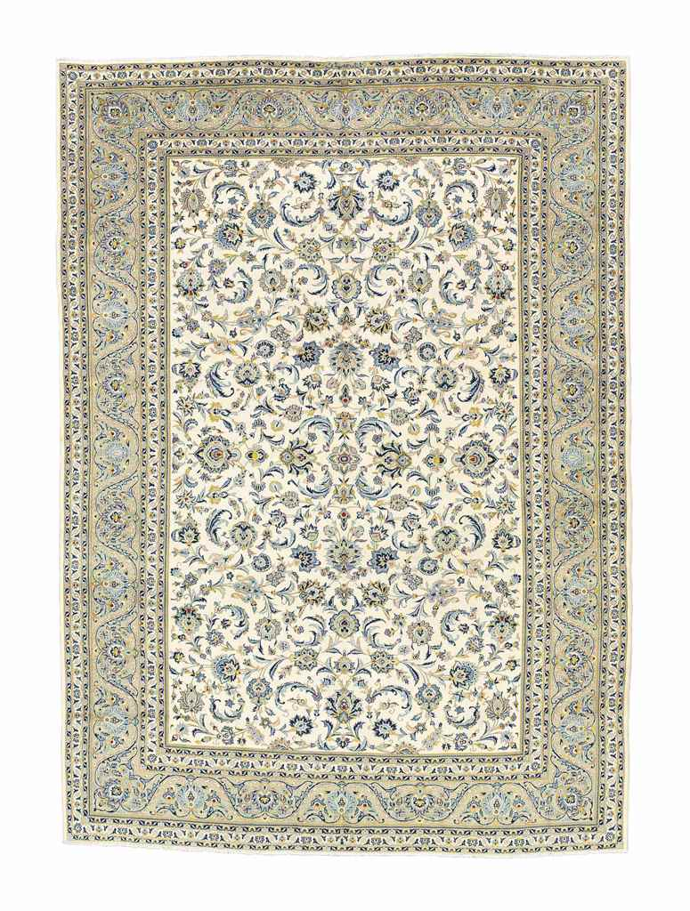 A SIGNED KASHAN CARPET