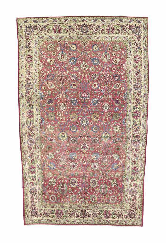 A VERY FINE SILK KASHAN CARPET