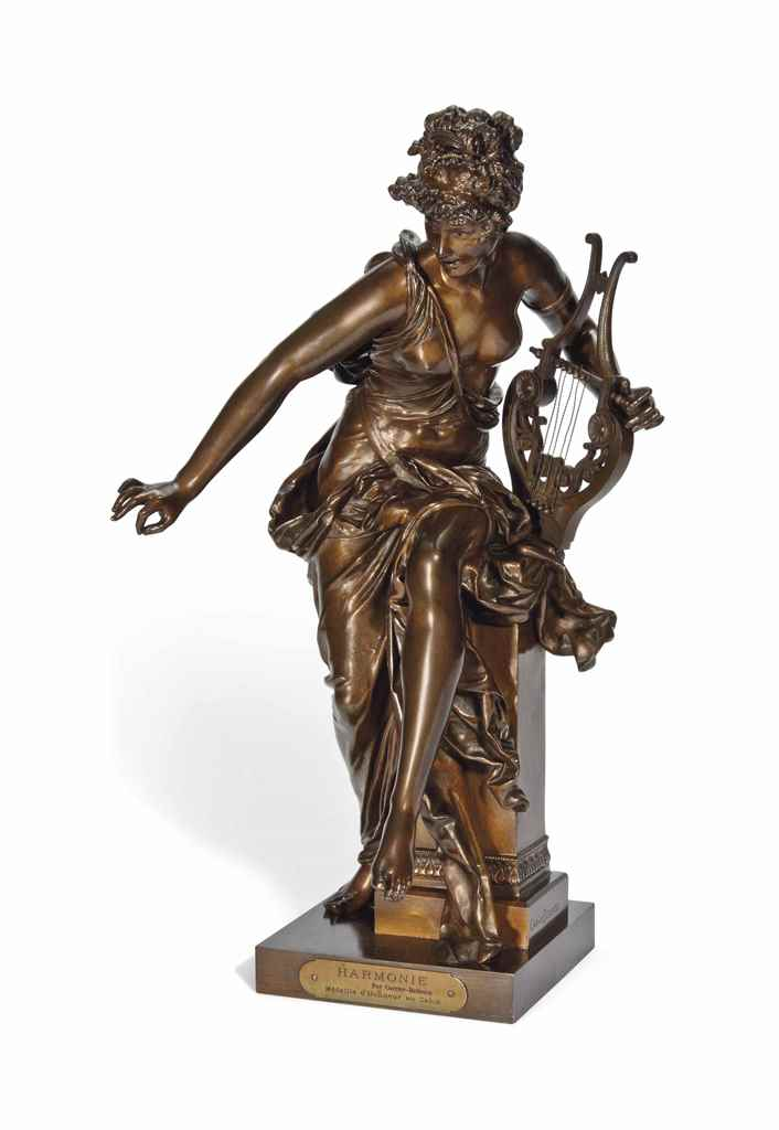 A BRONZE FEMALE FIGURE WITH A