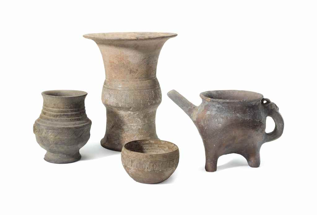 FOUR CHINESE GREY POTTERY VESS