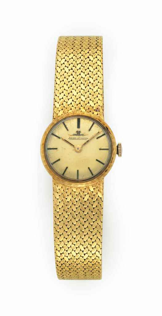 A GOLD LADIES WRIST WATCH
