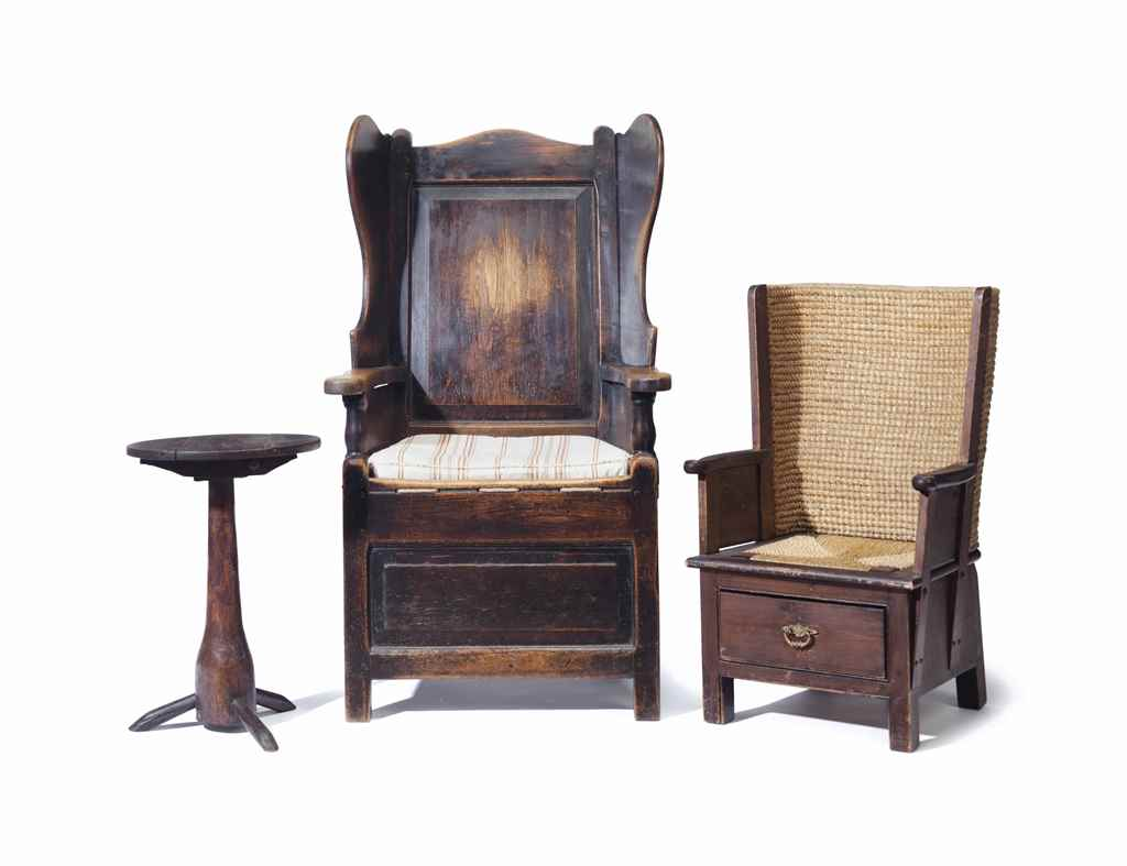 AN ENGLISH OAK WINGBACK CHAIR