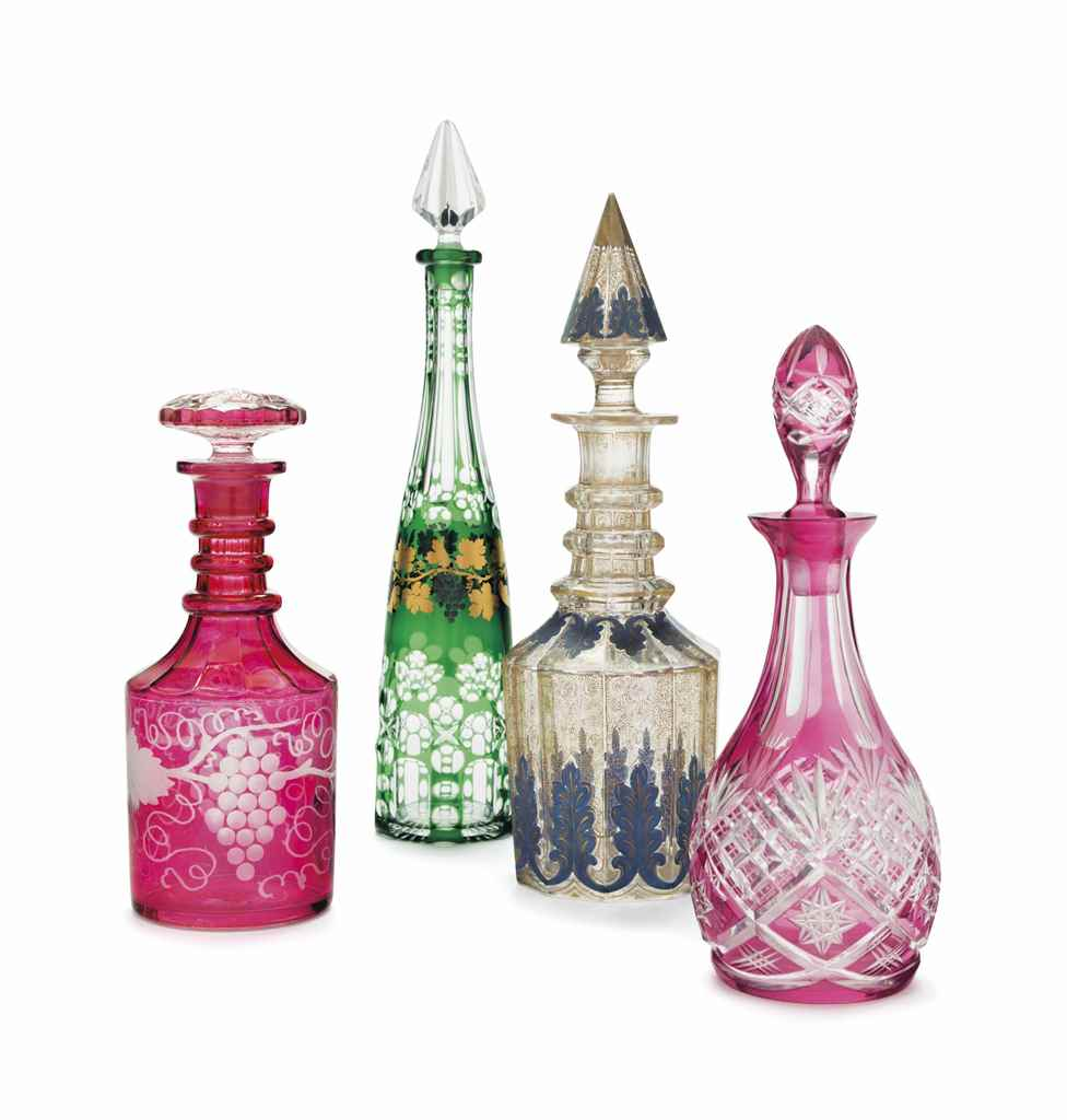 A GROUP OF FOUR GLASS DECANTER