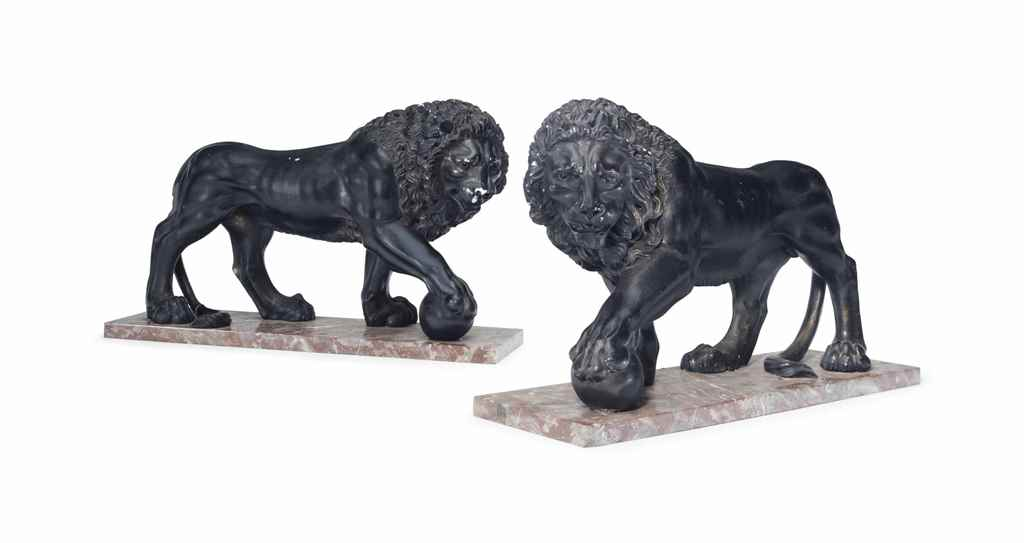 A PAIR OF BLACK-PAINTED PLASTE