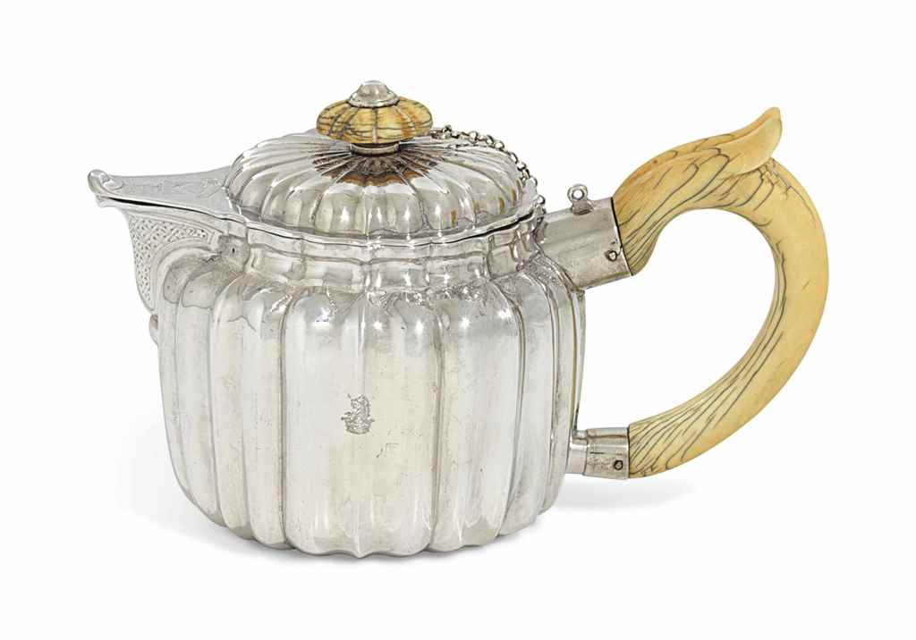 A GEORGE I SILVER TEAPOT