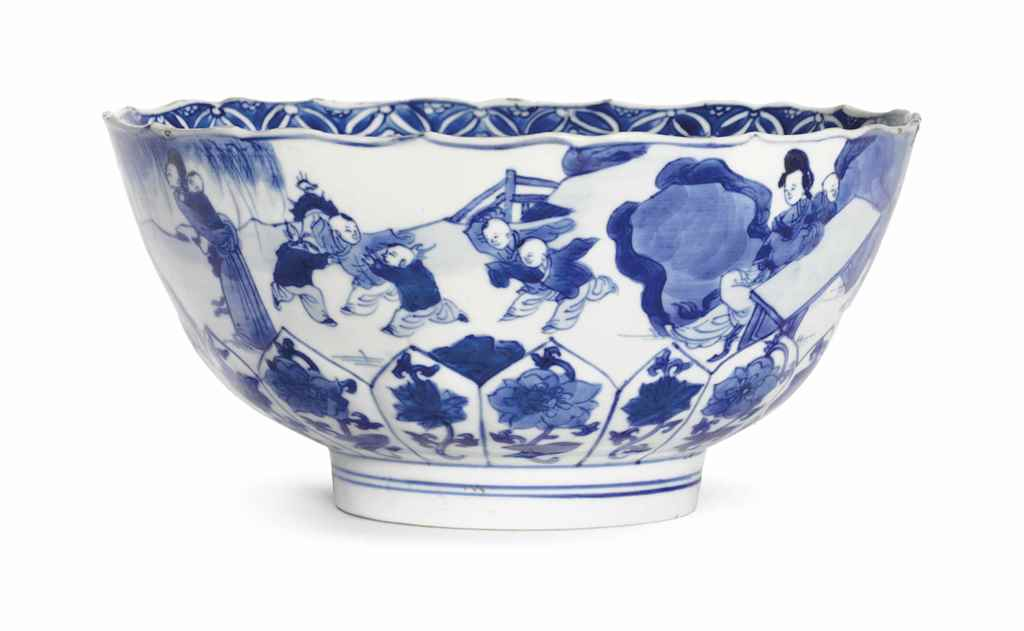 A BLUE AND WHITE LOBED BOWL