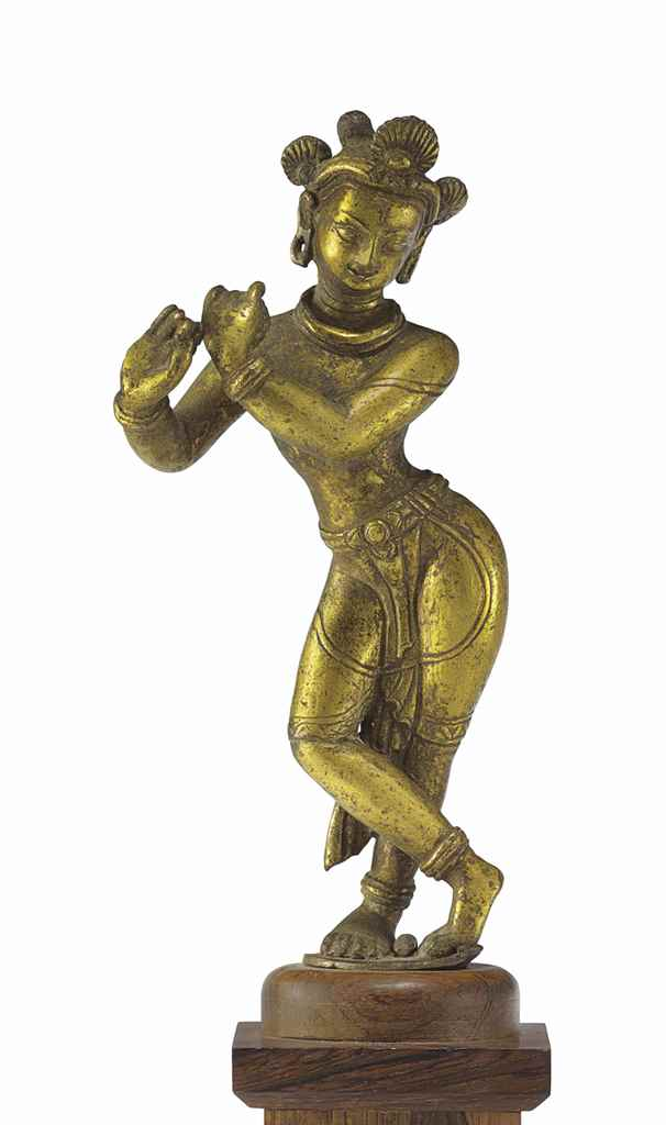 A BRONZE FIGURE OF KRISHNA VEN