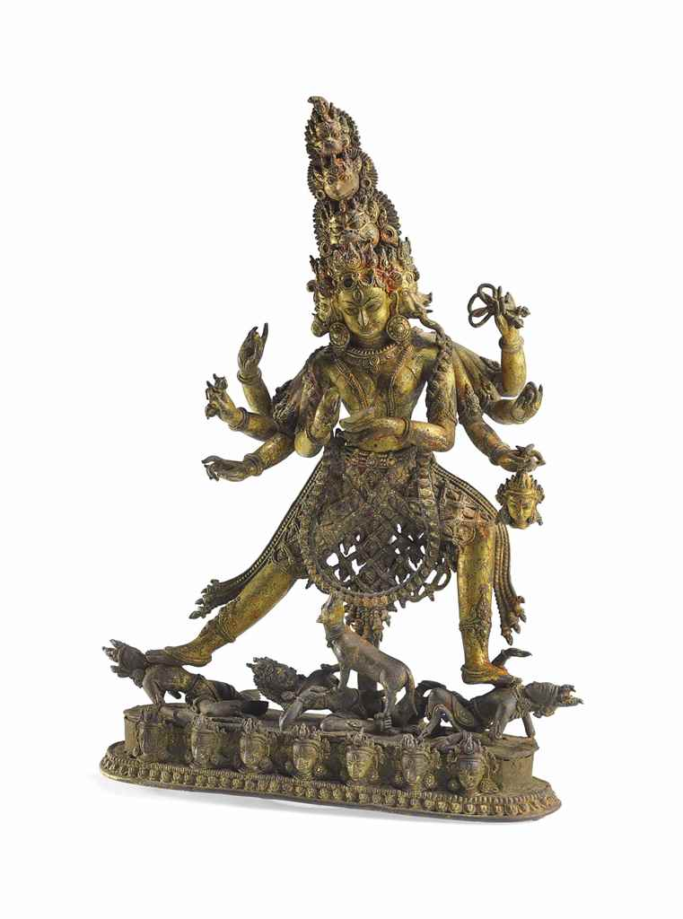 A RARE GILT BRONZE FIGURE OF G
