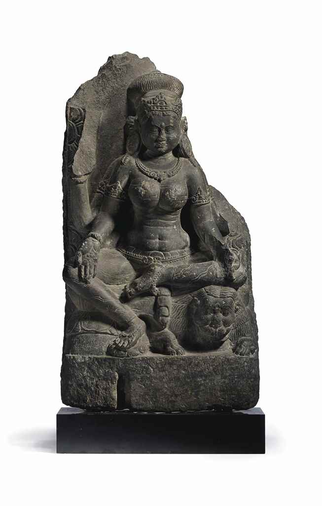 A BLACK STONE FIGURE OF DURGA