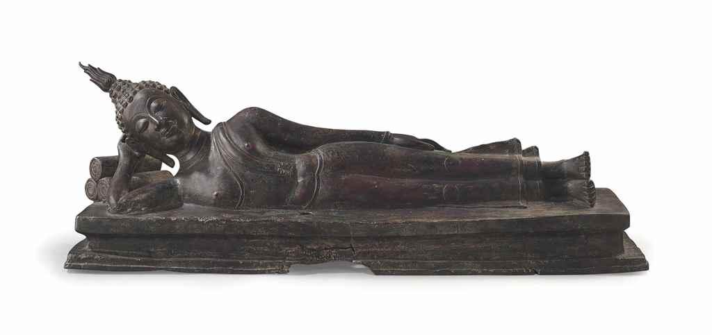 A bronze figure of Buddha in P