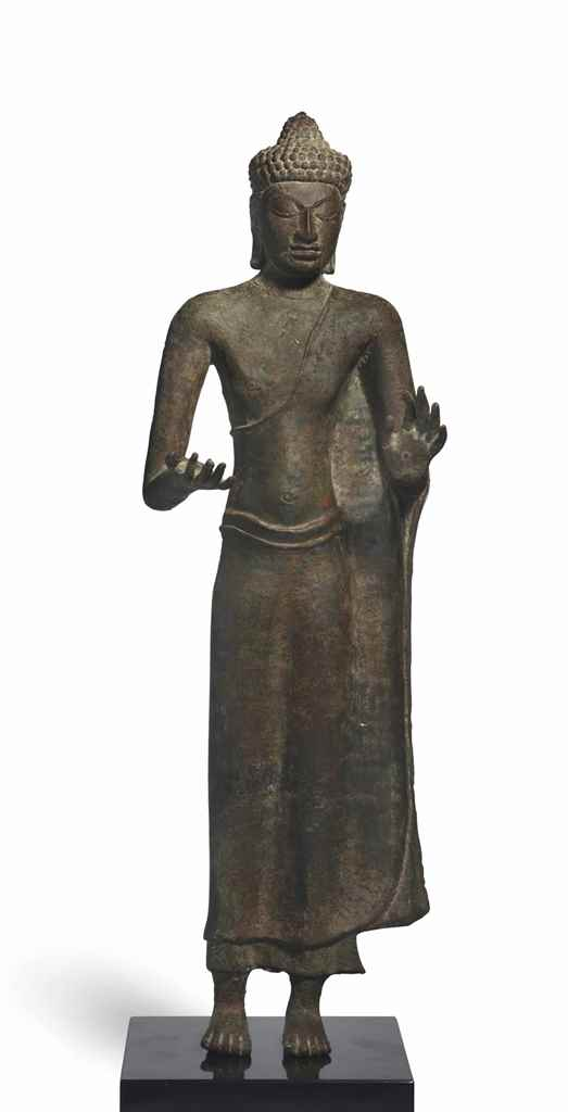 A BRONZE FIGURE OF BUDDHA