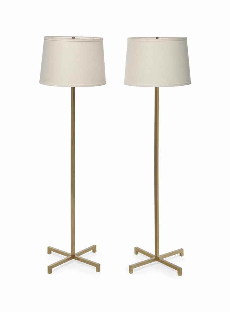 A PAIR OF MODERN BRASS STANDIN