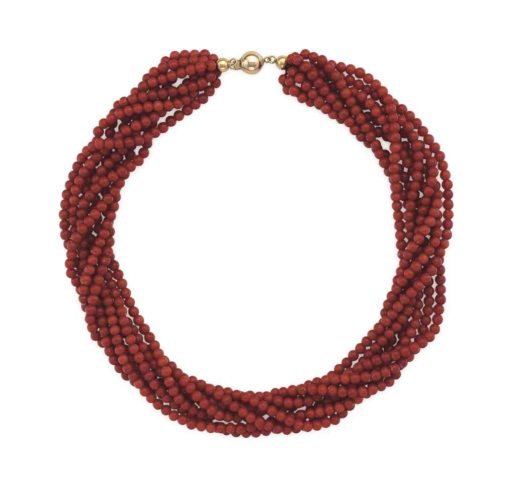 ~A CORAL BEAD AND GOLD NECKLAC