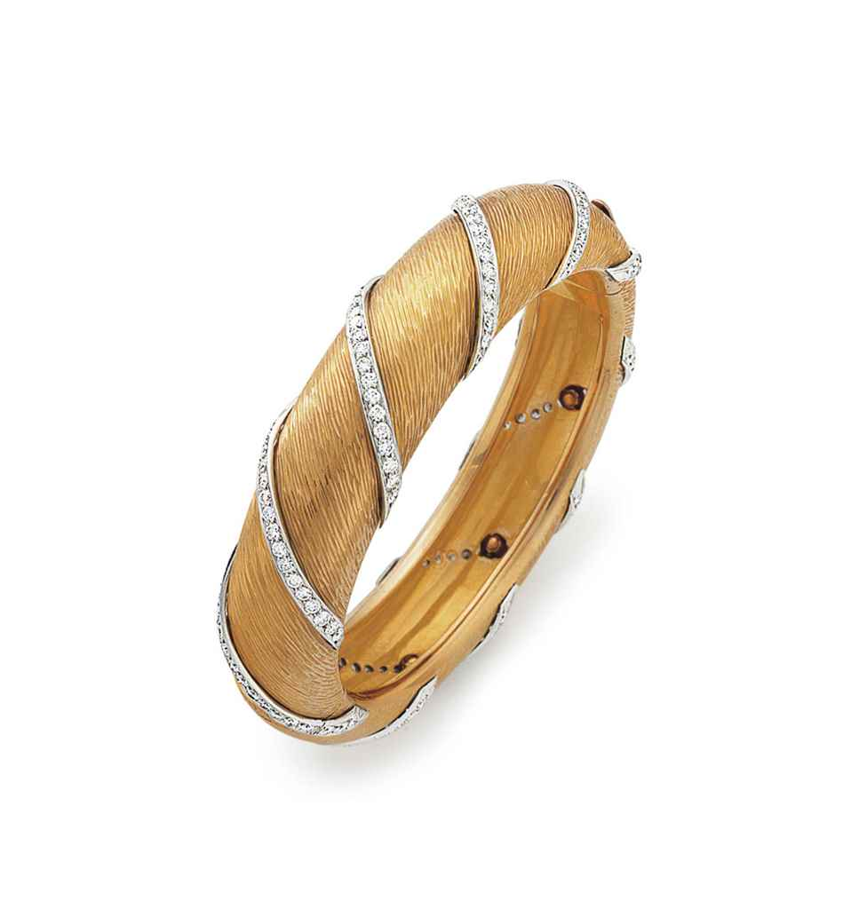 A GOLD AND DIAMOND BANGLE BRAC