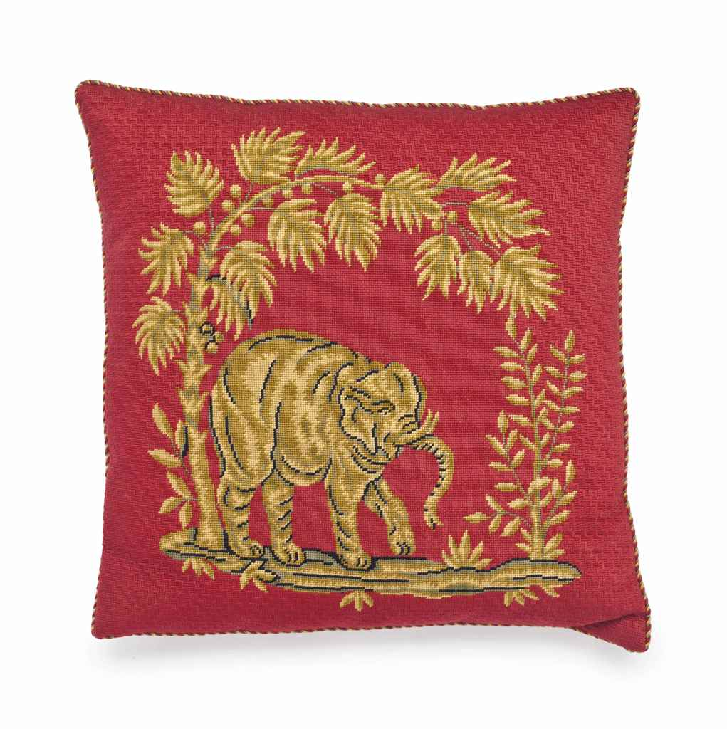 A RED AND BROWN NEEDLEPOINT CU