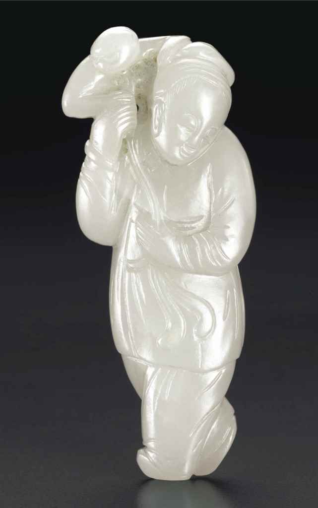 A SMALL WHITE JADE FIGURE WITH