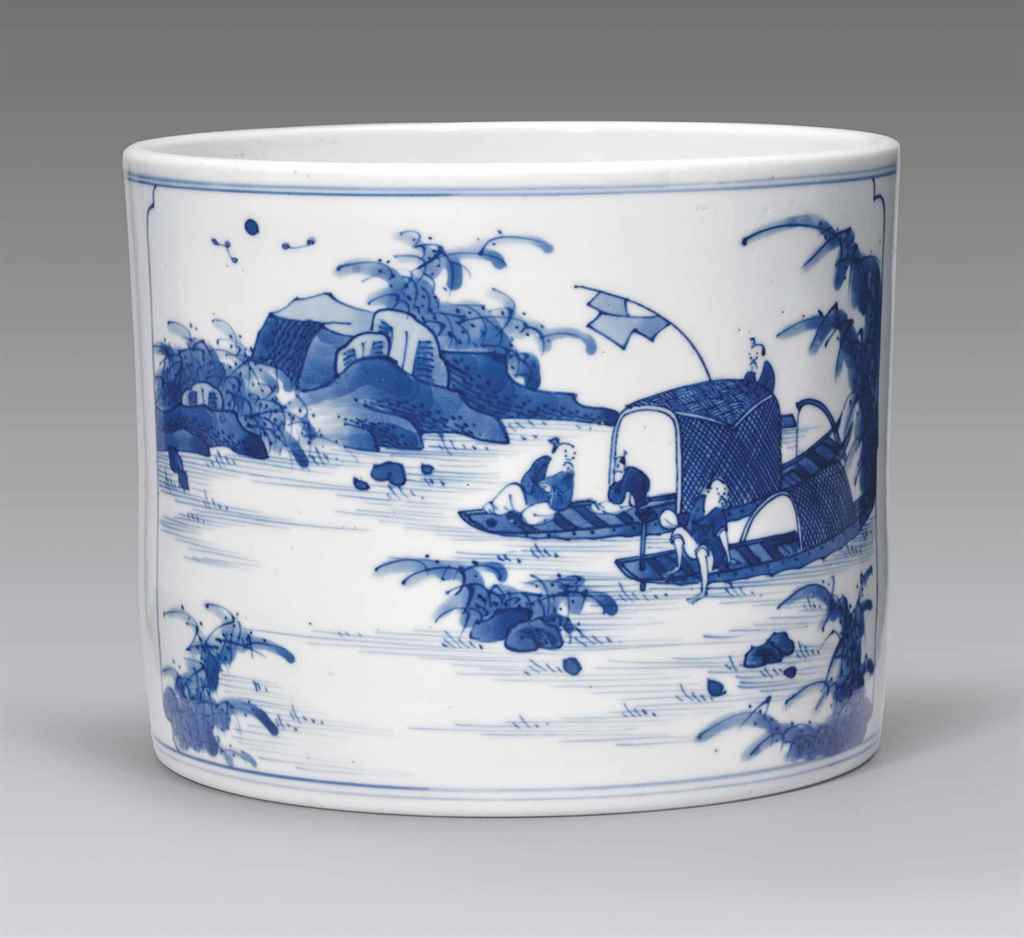 A BLUE AND WHITE BRUSH POT