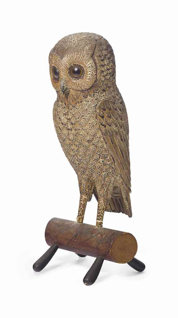 A CARVED AND PAINTED PINE OWL