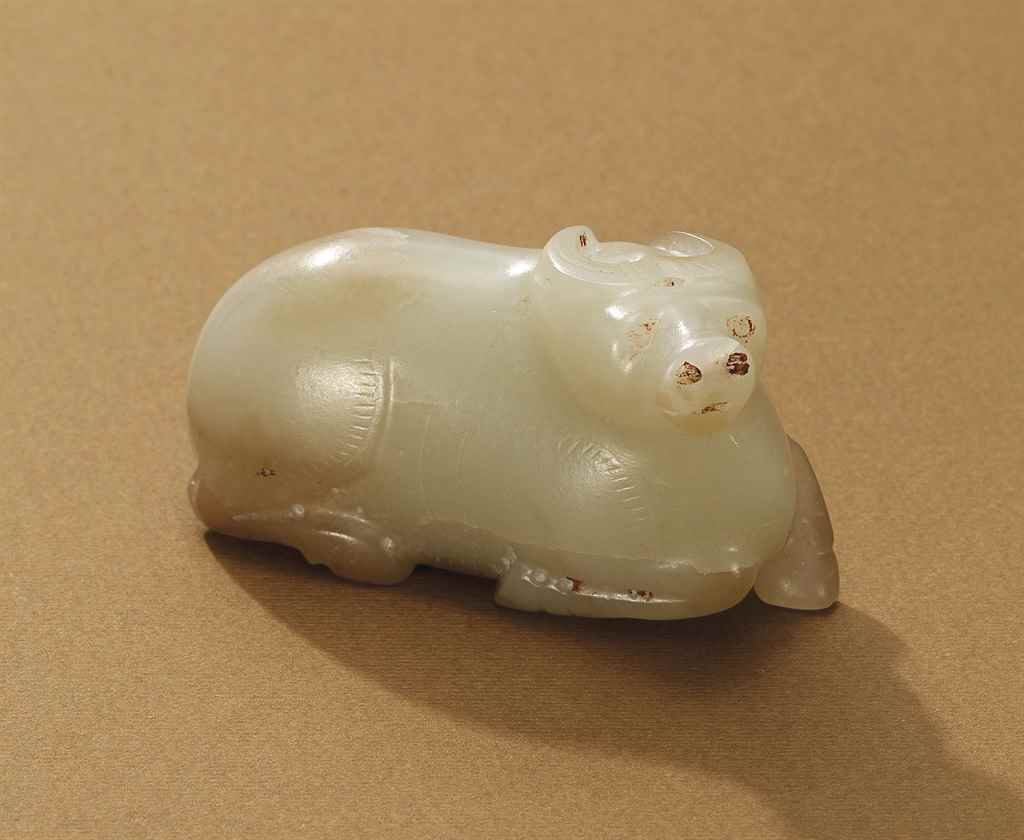 A CELADON JADE CARVING OF A BU