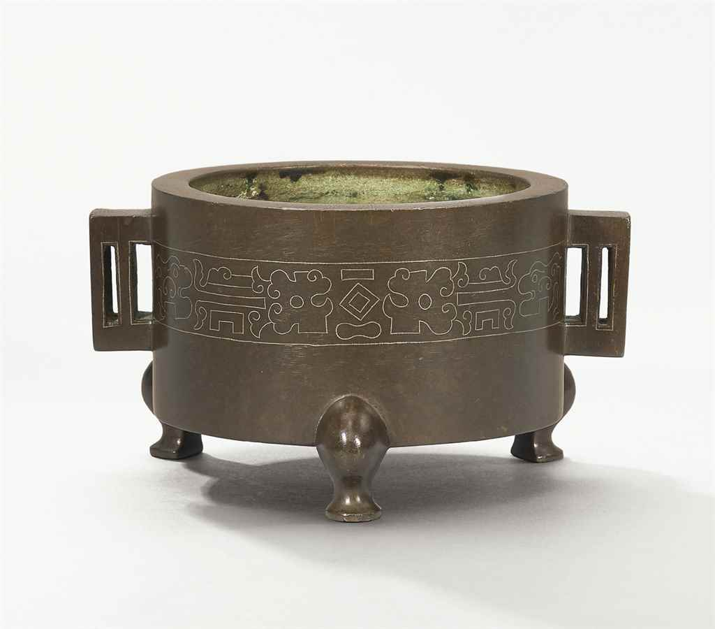 A SILVER-INLAID BRONZE CENSER