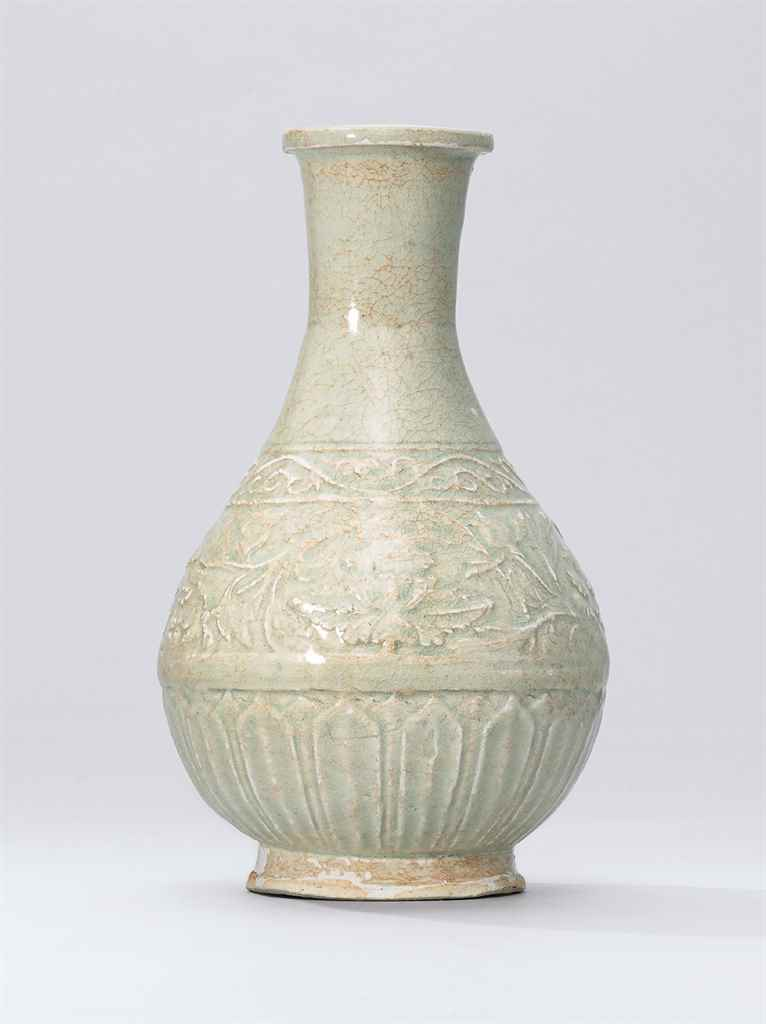 A QINGBAI MOULDED 'PEONY' VASE