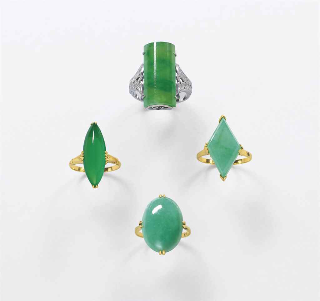 A GROUP OF FOUR JADEITE RINGS