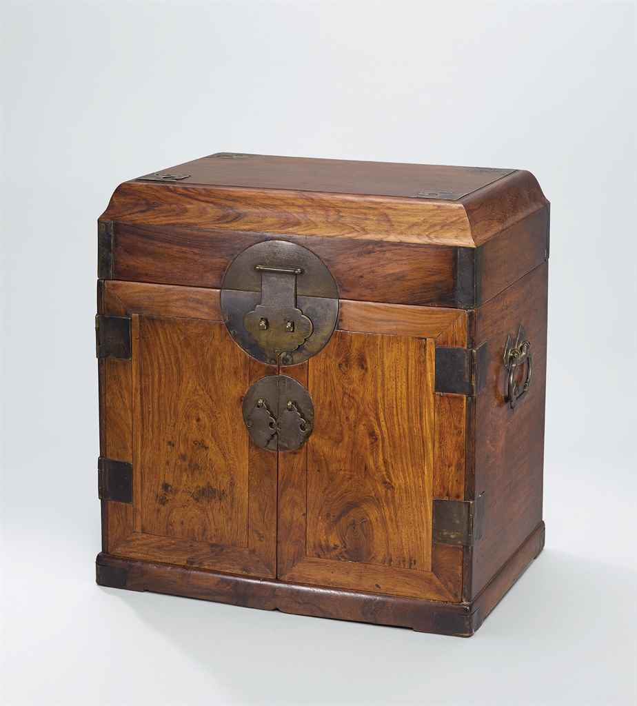 A HUANGHUALI STATIONERY CHEST,