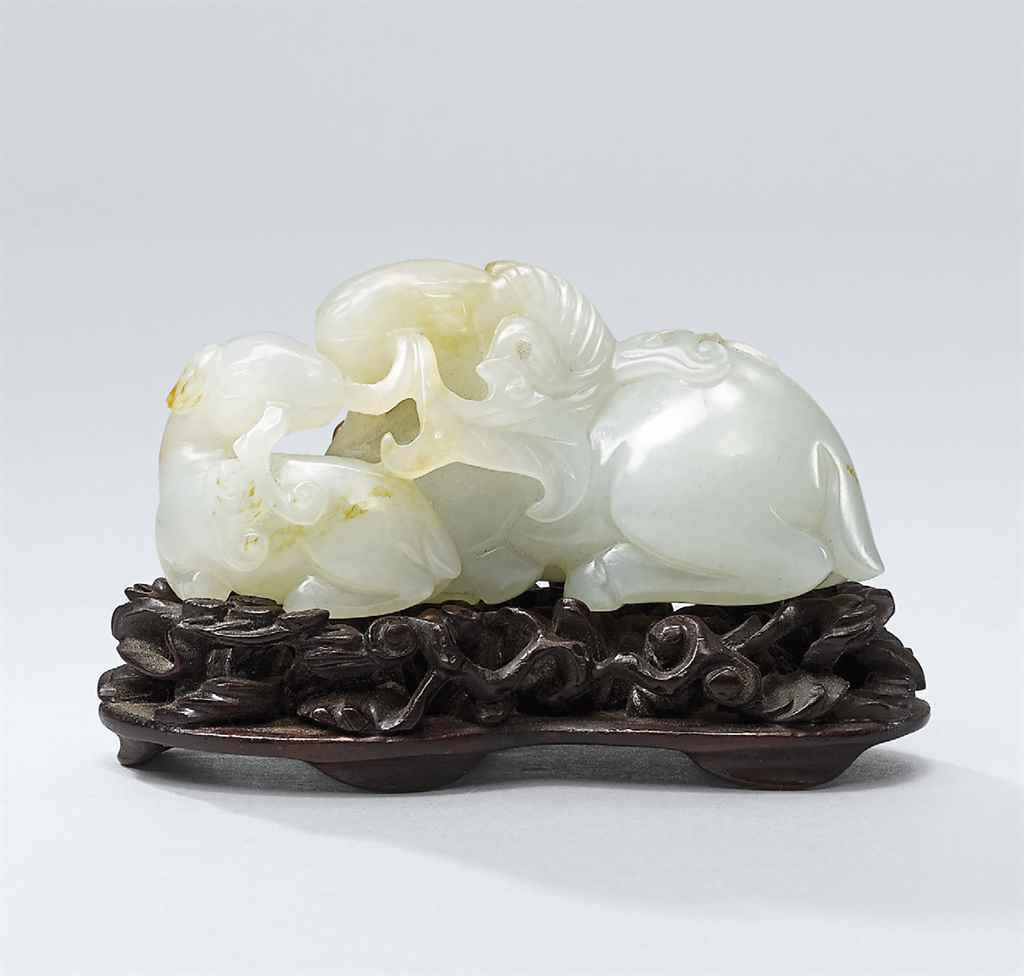 A SMALL WHITE JADE CARVING OF