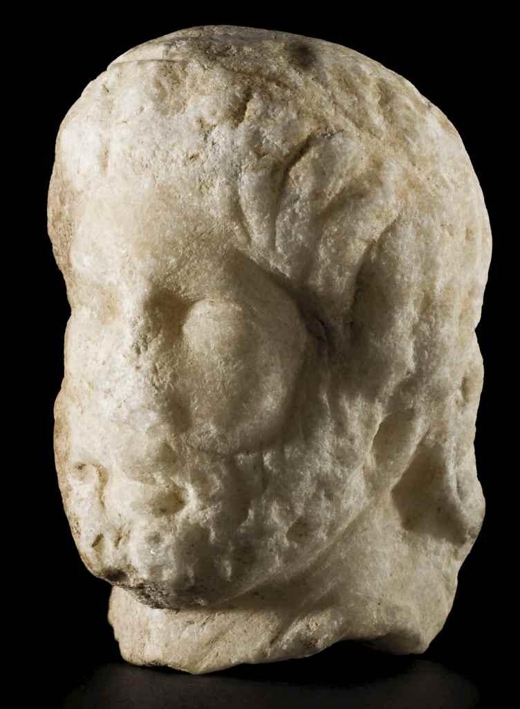 A GREEK MARBLE HEAD OF ZEUS