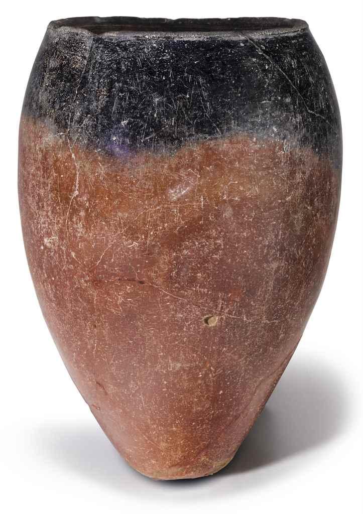 AN EGYPTIAN BLACK-TOPPED POTTE