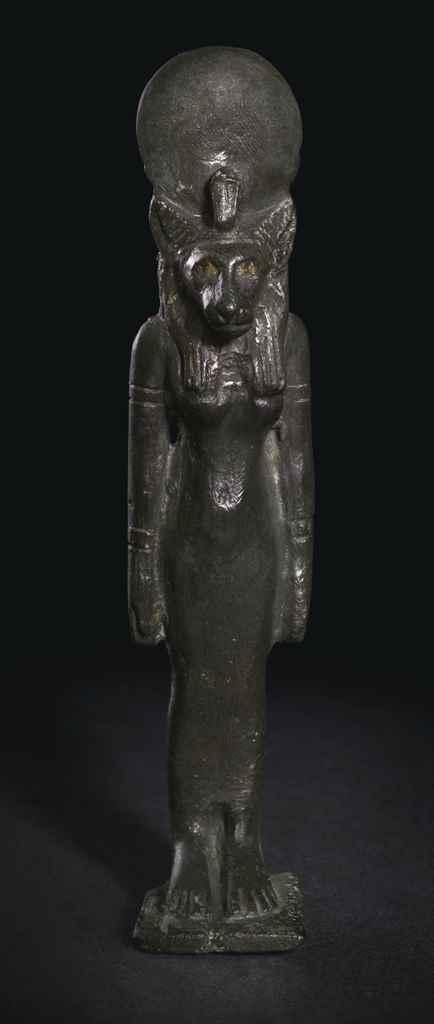 AN EGYPTIAN BRONZE BASTET