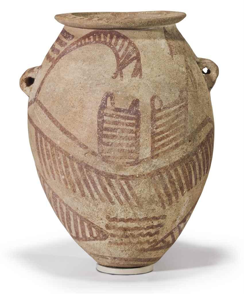 AN EGYPTIAN PAINTED POTTERY JA