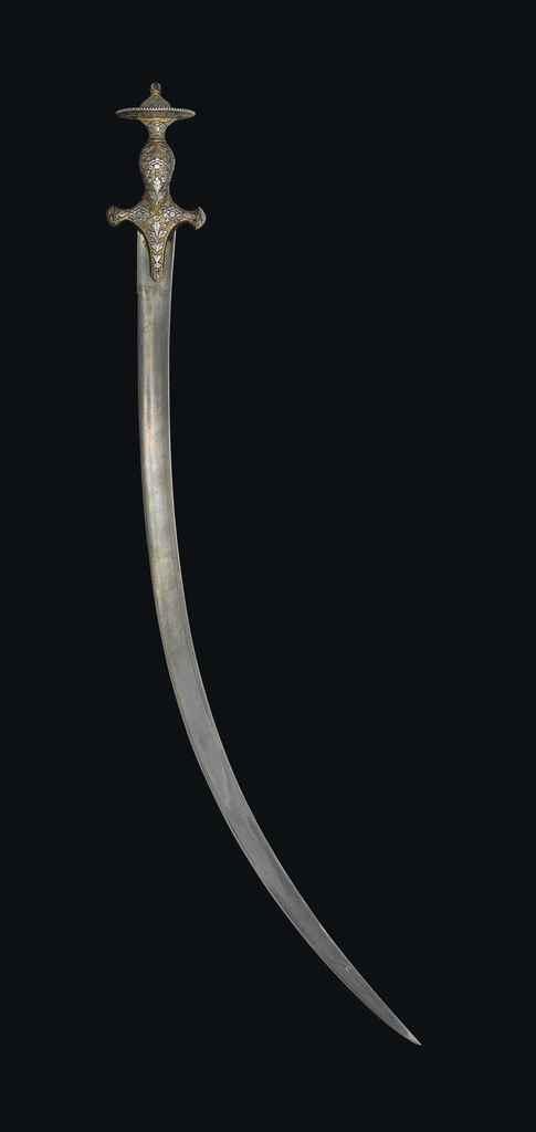 A FINE INDIAN SWORD (TULWAR)