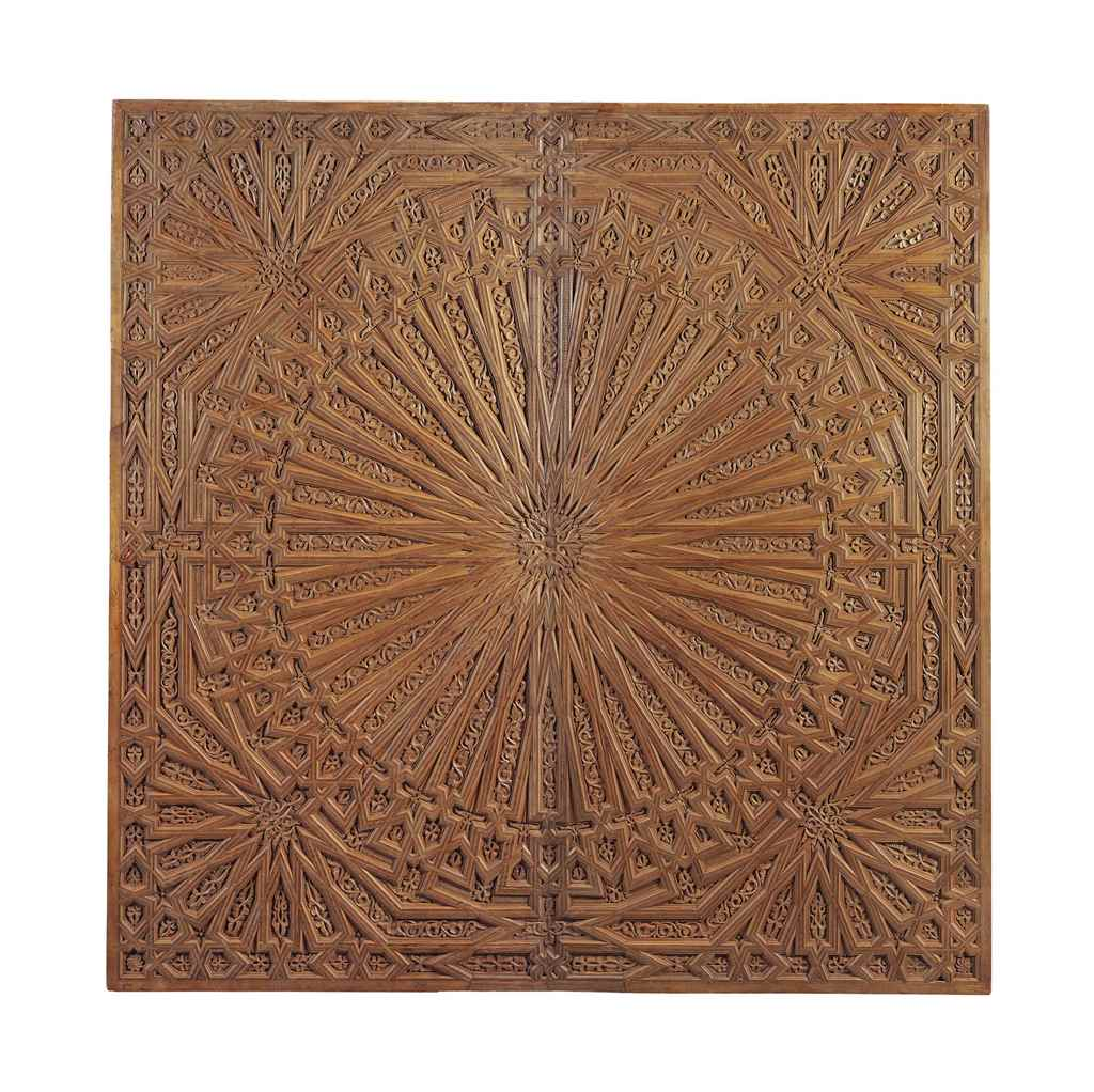 A DEEPLY CARVED WOODEN CEILING
