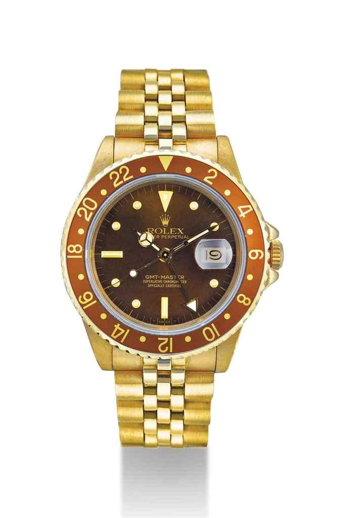 ROLEX. AN 18K GOLD AUTOMATIC D